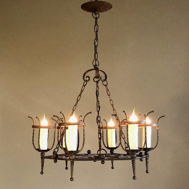 Antique Country French Wrought Iron Chandelier is the perfect choice for the casual decor! Forged iron baskets are...