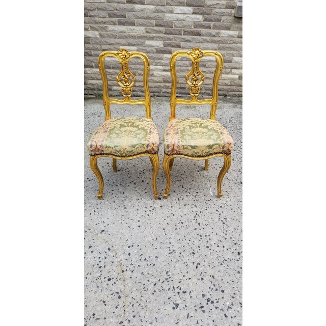 This is a gorgeous pair of antique giltwood Louis XV or Rococo style parlor chairs, with a 3 tone silk damask upholstery...