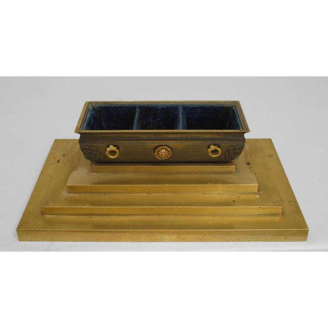 Early 19th century French Empire bronze inkwell cast in the form of Napoleon's casket resting upon a three step base. The...