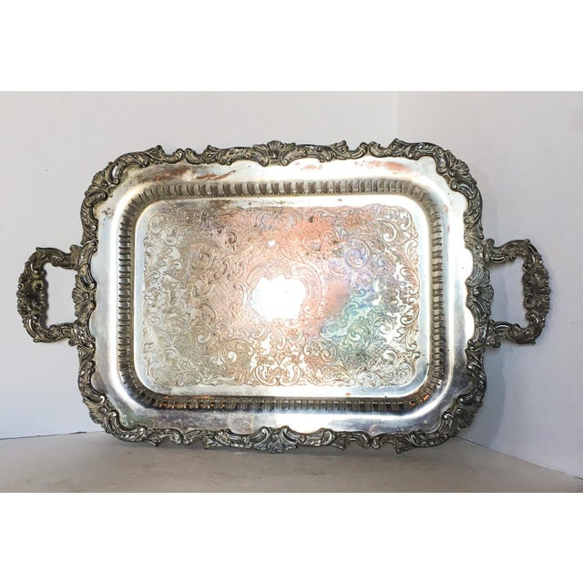 A well-loved antique silverplate tray, most likely from the mid 19th century. Silver plate wear in some areas with the...