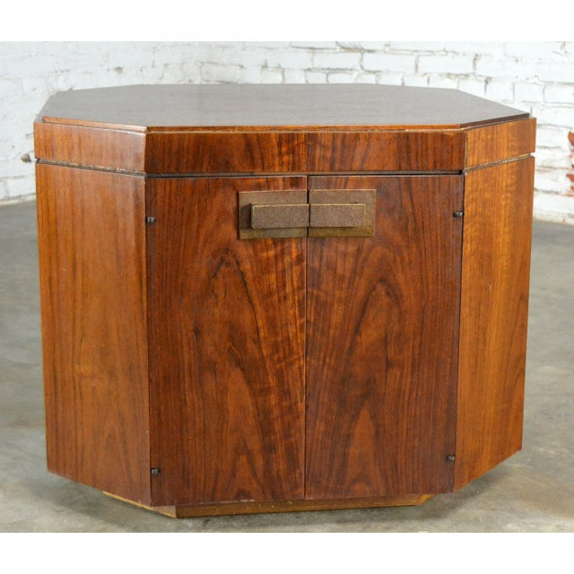 This is a fabulous chest style end table by the Founders Furniture company circa 1965 and maintains its original hang tag....