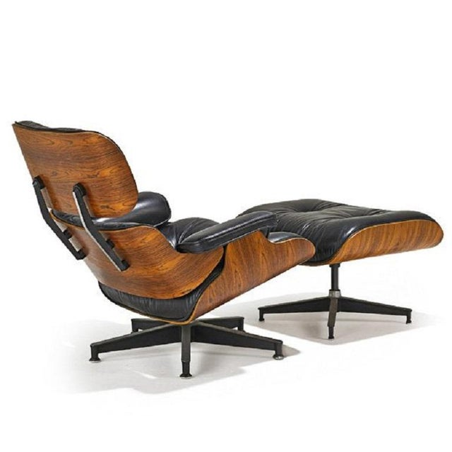 Charles and Ray Eames rosewood and leather lounge chair with matching ottoman. Model no. 670 and 671.