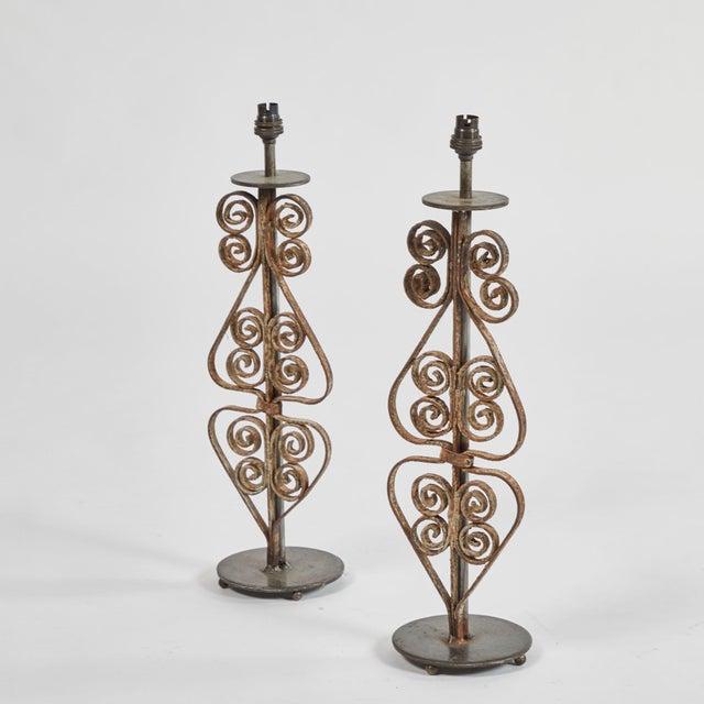 Pair of iron lamps with custom shades, originating in England, circa 1880.