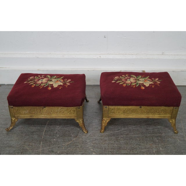 High quality, pair of antique small rectangular brass footstools with aesthetic design and red floral embroidered tops,...