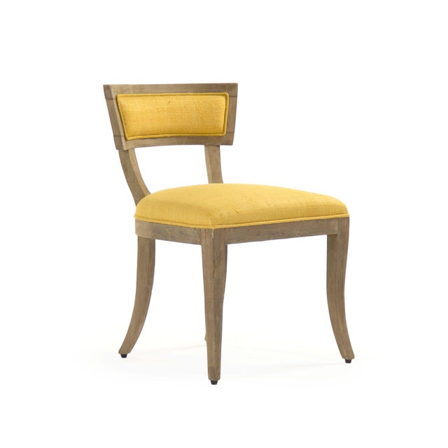 Side chair with yellow raw silk upholstery, four curved legs, padded back, and foam filling.