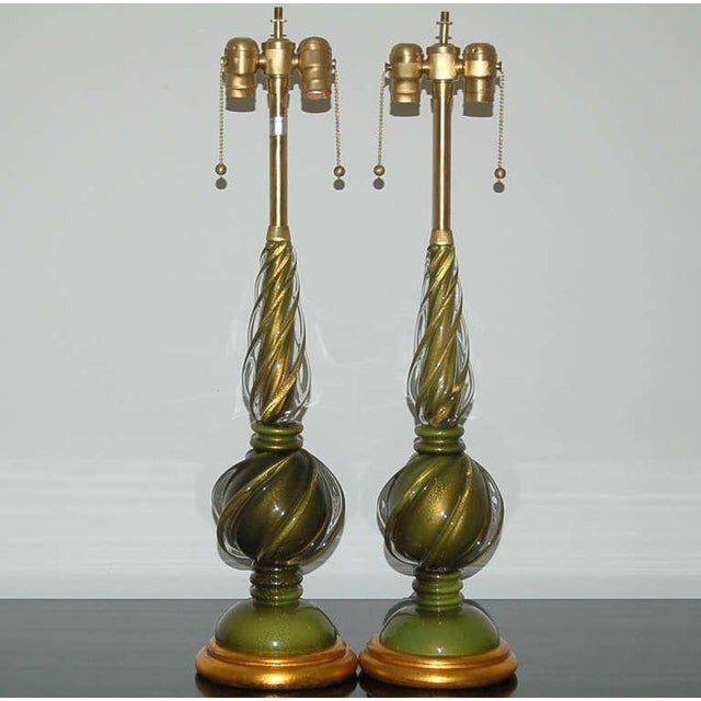 Matched pair of vintage Murano glass table lamps in AVOCADO GREEN from The Marbro Lamp Company. The Venetian glass is...