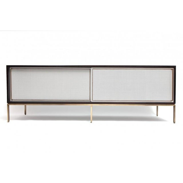 Regeneration 379 credenza shown here with ebonized walnut case, bronze frame and painted caned doors. This piece is in...
