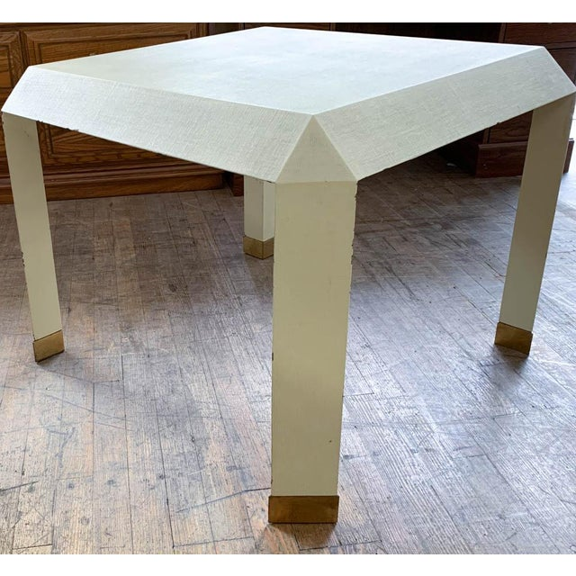 This table is mid century coolness in a versatile form. Attributed to Karl Springer in design, the hard mesh like surface...