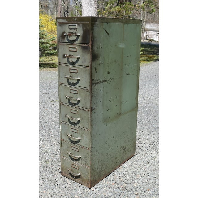Vintage industrial metal file cabinet by Yawman and Erbe. Faded worn color on the exterior clean drawers on the interior....