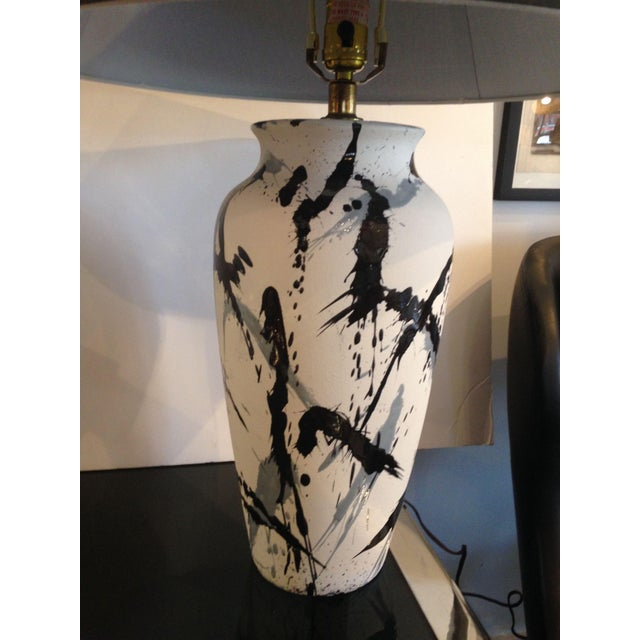 Pair of vintage, black and gray graphic splatter glaze over matte white finish table lamps in the style of Jackson...