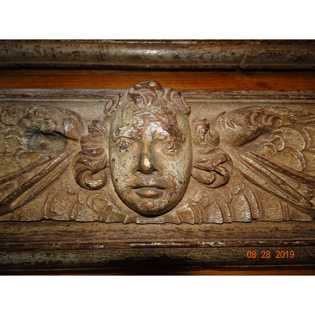 Stunning pair of 18th Century Italian walnut panels depicting a putti with curly hairs and spread wings. Fruit full swags...
