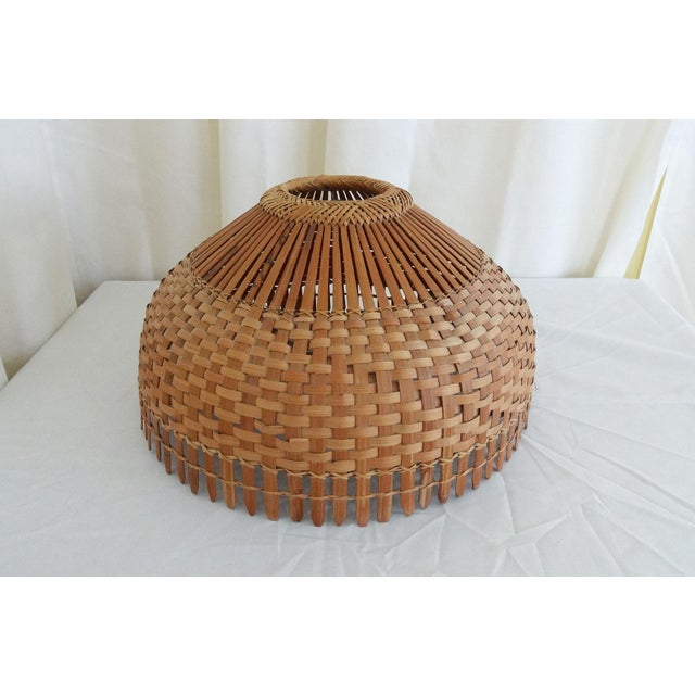 A great mid century woven bamboo/rattan lamp shade that could be use for a table top lamp or hanging light fixture.