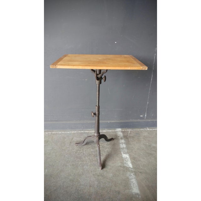 Great adjustable cast iron drafting table with a wood top. You can adjust the hight from 31'' to 47'' and have the top...
