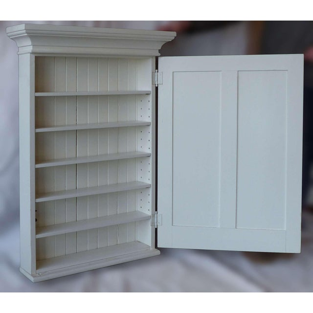 1880's white painted wooden wall mount medicine cabinet with mirrored door. This has been completely restored, refinished...
