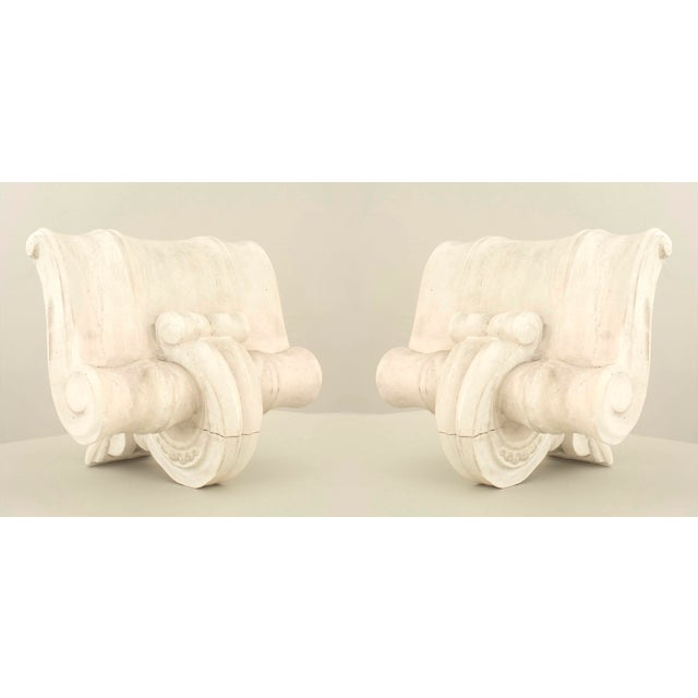Pair of French, 1940s neoclassic design white plaster capital wall sconces with back light and scroll form (possibly Serge...