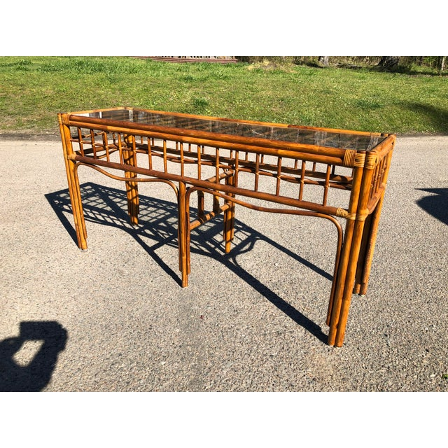 Great vintage rattan console. Made in the 1970s.