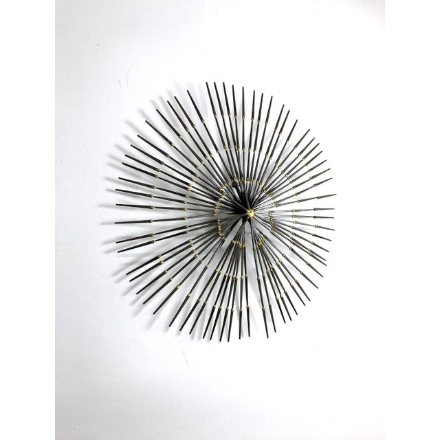 Large welded nail brutalist wall sculpture circa 1970's. Layered spokes of nails welded in brass creates a spiral...