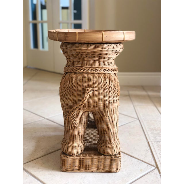 We are very pleased to offer a stunning handwoven wicker rattan elephant side accent tray table, circa the 1960s. This...