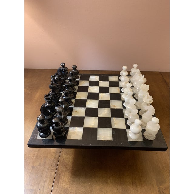 Makes a statement and functional. Perfect for the Chess lover. Pieces feel smooth in the hand. Heavy set. Great Vintage...