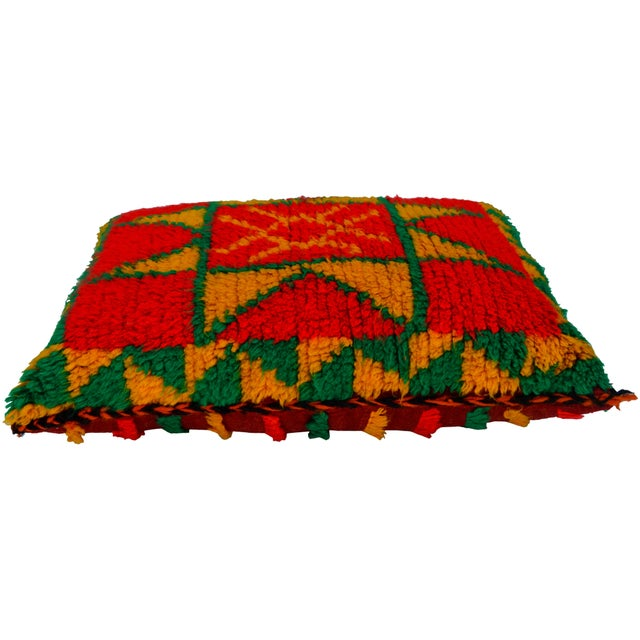 One-of-a-kind vintage Moroccan pillow handwoven by the Berbers of the High Atlas Mountains. Finely-woven design with...