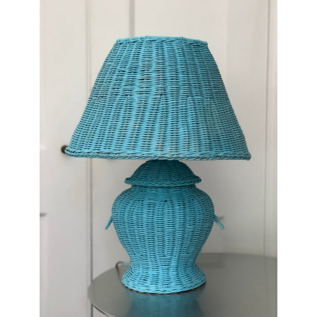 Charming vintage blue wicker urn shaped table lamp and matching shade.