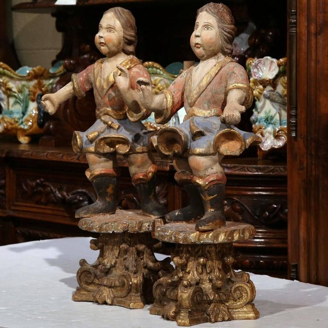 Beautiful pair of antique carved figurines from Italy, circa 1780, depicting two young boys standing on carved gilded...