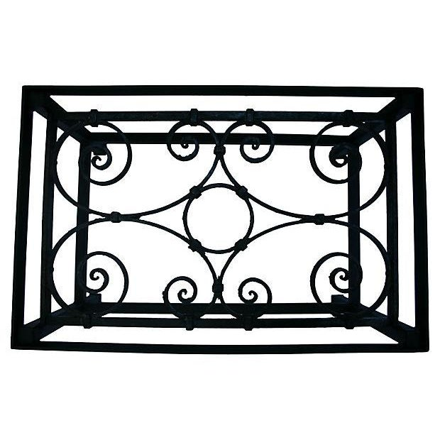 Beautiful coffee table made with an early-20th-century wrought iron scroll balcony segment. Table is flat black steel and...