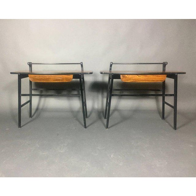 Elegant pair of end tables with non-wood rosewood veneer over black lacquered bases. Simple and chic profiled tops with...