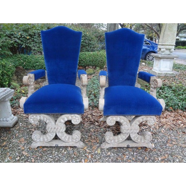 Stunning pair of French 1940s Gothic style Cerused oak chairs attributed to Francisque Chaleyssin. This versatile pair of...