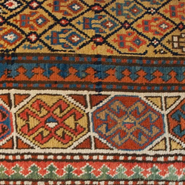 A late 19th century Persian Gangeh carpet with wonderful multicolored geometric floral pattern surrounded by an ornate...