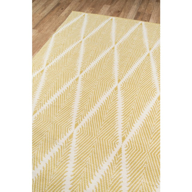 Traditional patterns take new form in the tribal design of this decorative area rug collection. Each rug is defined by an...