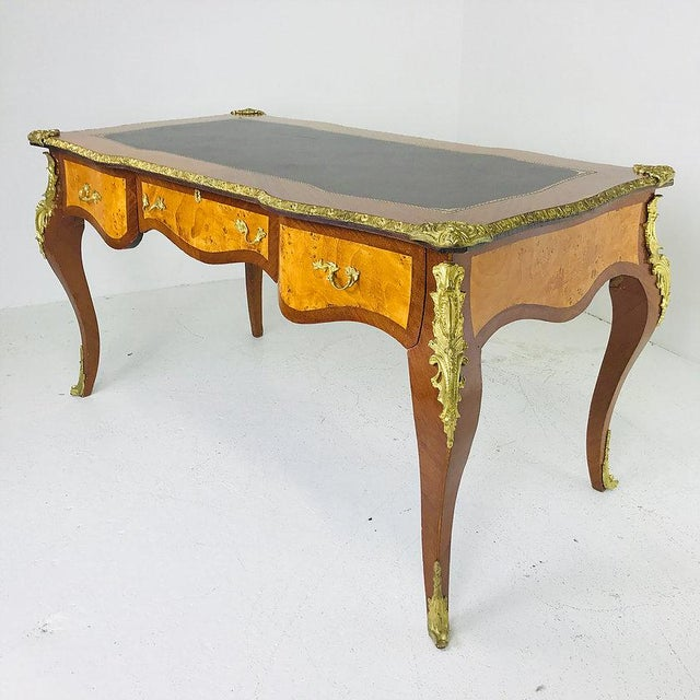French Ormolu Desk with Burl Wood & Leather Top. Add a touch of opulence and tradition to a modern space to create a...