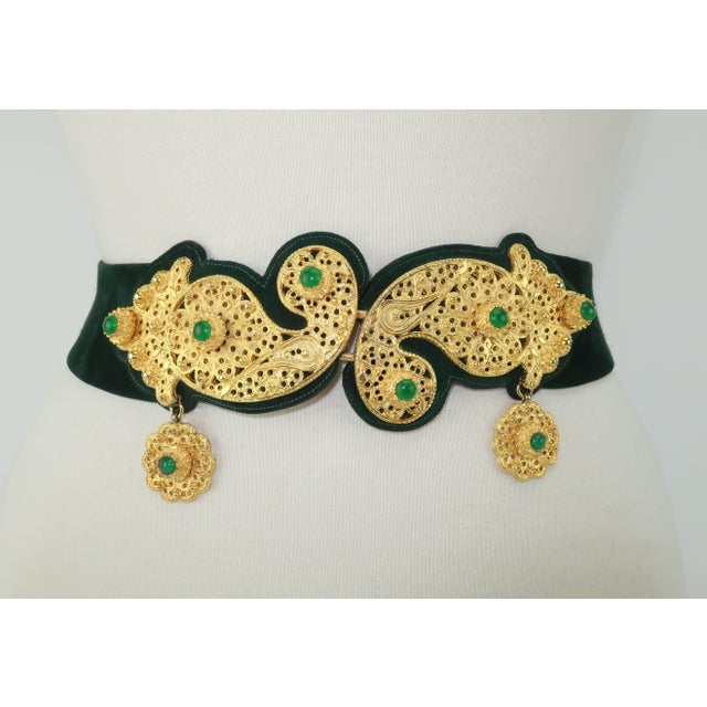 Opulence abounds with this rich Judith Leiber for Saks Fifth Avenue gold filigree green suede belt. The detailed jewelry...