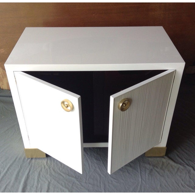 An exquisite chest from the Barbara Barry Collection for Baker Furniture. White lacquer over solid mahogany. Dual doors...