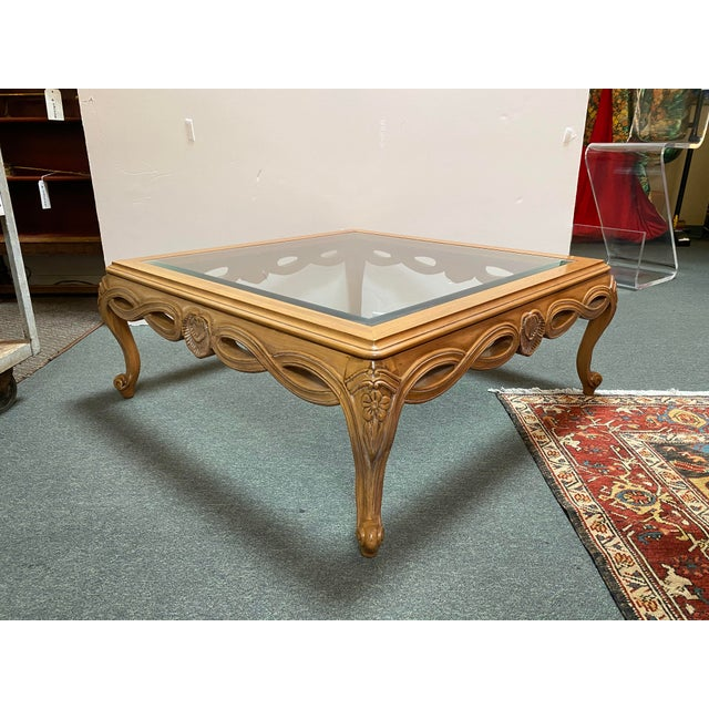 Design Plus Gallery presents a Century Furniture Chardeau Collection Coffee Table. Cabriole legs support the visually...