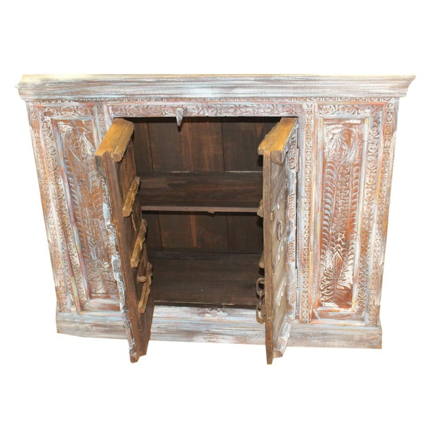 Antique furniture bring vintage charm to your home with this distressed cabinet square carved. The chest comes from India...