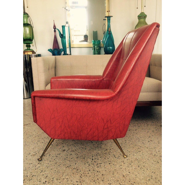 This is a pair of unusual Italian chairs in the style of Gio Ponti. They feature solid brass legs, high backs, and are...