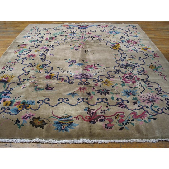 Antique Chinese Art-Deco Rug with beige background layered by an array of vibrant blues and orange colors.