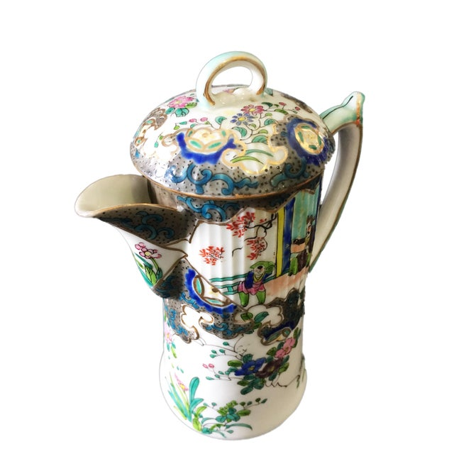 Superb elegant shape Old Asian lidded tea pot decorated with hand-painted enamel paints giving parts of the pot a raised...