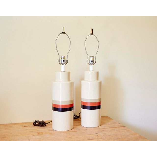 Mid Century Modern Philmar Sandel Ceramic Lamps - Set of 2. Two vintage ceramic cylinder lamps in cream with taupe, orange...