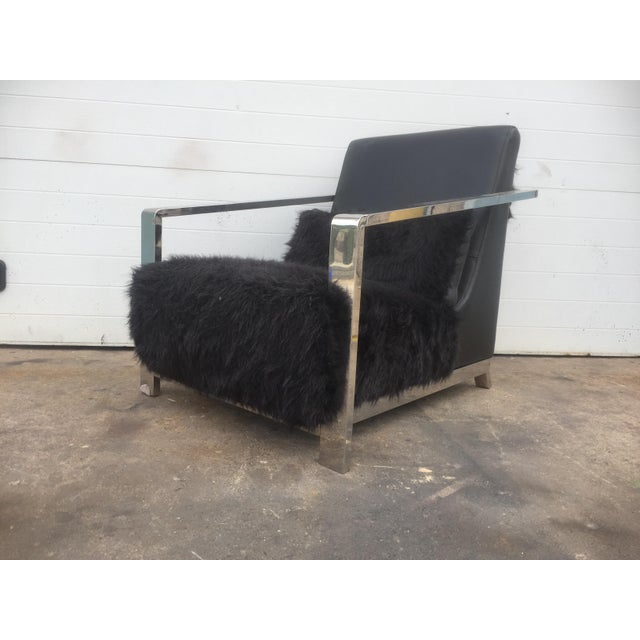 This listing is for a modern faux fur and leather upholstered chrome frame lounge chair. Condition-very good used...