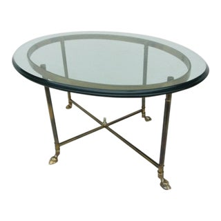 20th Century Hollywood Regency Glass Top Brass Cloven Foot Coffee Table For Sale