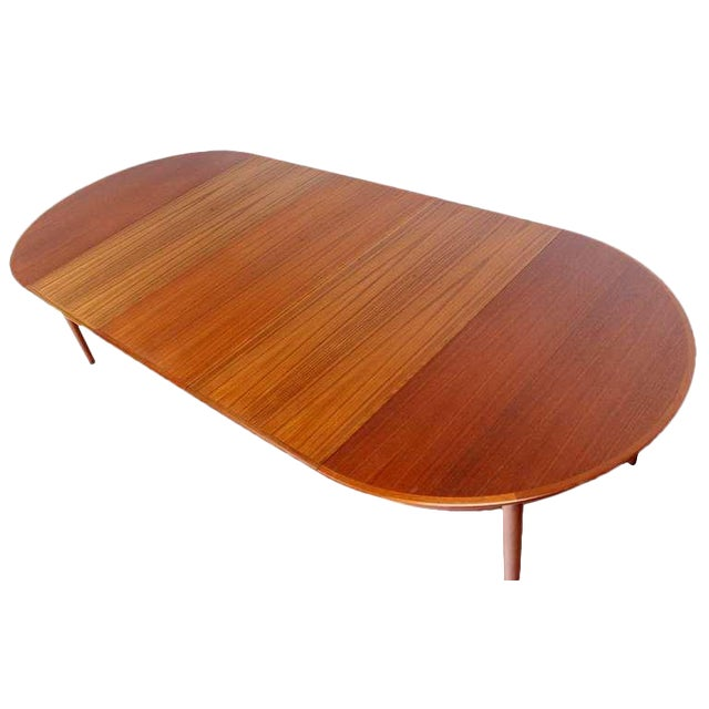 Danish Mid-Century Modern Round Teak Dining Table with Three Leaves For Sale