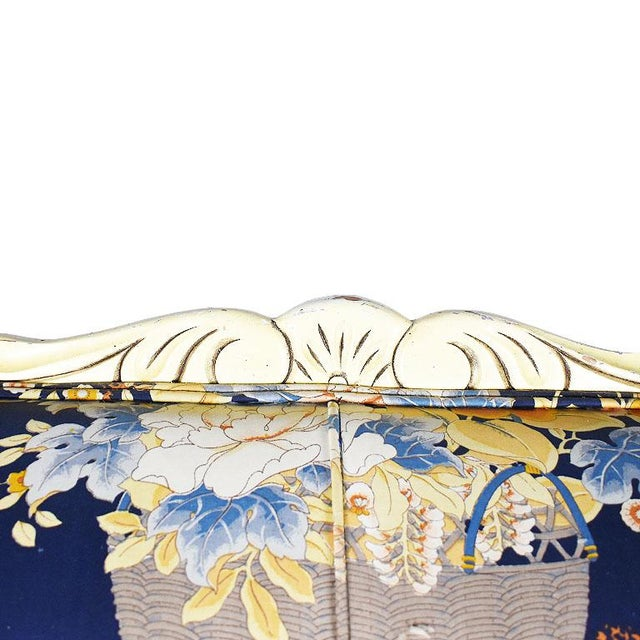 Floral Louis XVI style sofa in blue. The seat back of this beauty is framed in a carved wood detail around the edges. At...