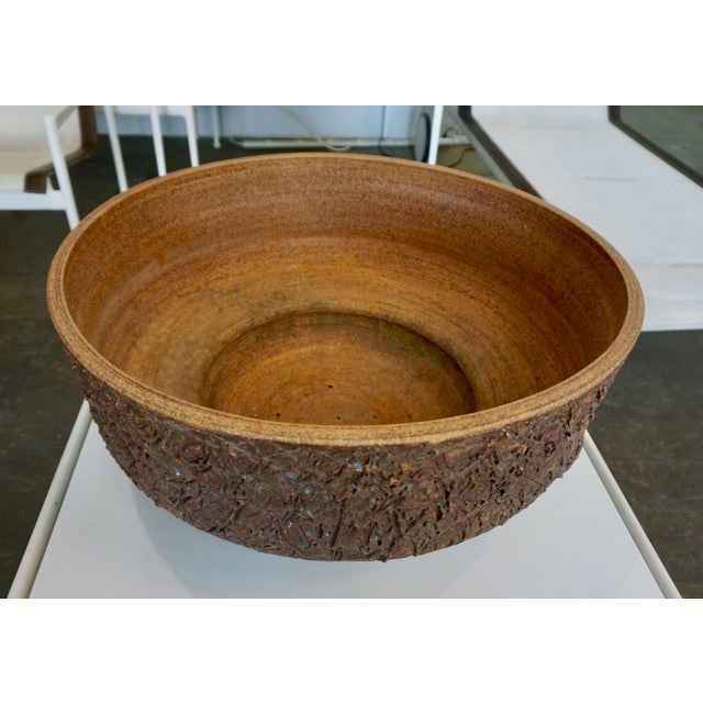 Handmade 60's stoneware vessel,incised texture. Raul Coronel was a Los Angeles based ceramicist well known for his...