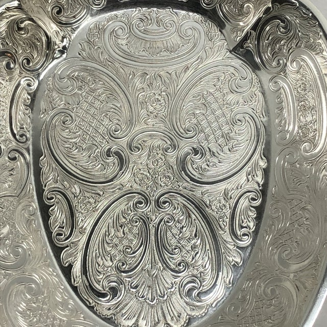 Classic silver plate serving bowl by English maker Barker Ellis. Handle is a stylized scallop shell. The entire bowl is...