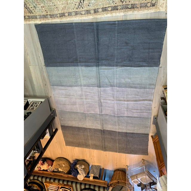 This vintage hemp runner from Turkey has been given a new chic life with blue ombre over-dye. Hand knotted, this rug works...
