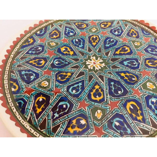 Polychrome hand painted and handcrafted ceramic wall decorative plate with polychrome Ottoman floral design. This is an...
