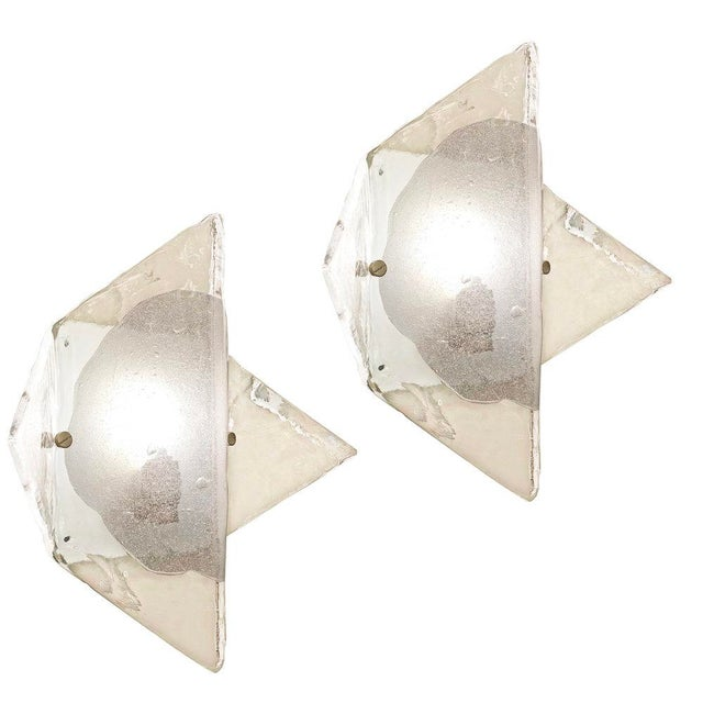 Beautiful Murano glass wall lights designed by Carlo Nason for Mazzega in the 1960s. Hand blown in a shape reminiscent of...