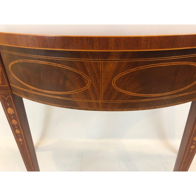 Classically designed Historic Charleston collection Baker serpentine console table of rich flame mahogany having pretty...